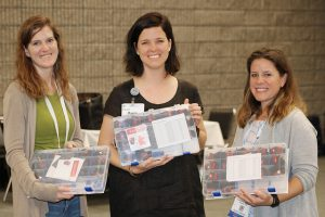 women showing off craft kits