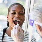 Woman getting mouth swab test