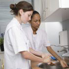 health workers washing hands