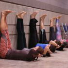 yoga practitioners with legs on wall