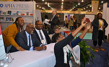 woman taking selfie with racism book authors