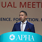 Sandro Galea at lectern with APHA logo