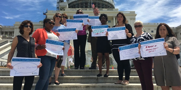 people on Capitol steps holding gun violence prevention signs