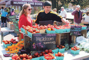 Shoppers browse for tomatoes at the City of Falls Church, Virginia, Farmers Market