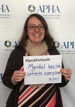Jessica Pollard holding Mental health affects everyone sign
