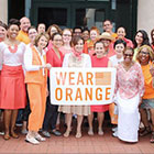 APHA staff with Wear Orange sign